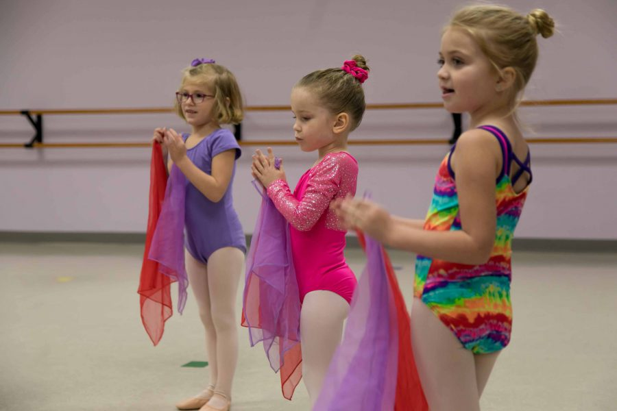 three young female dancers in leotards and tights taking a tiny twos dance class